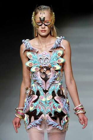 A model presents a creation by Manish Arora during the Spring/Summer 2013 ready-to-wear collection show on September 27, 2012 in Paris. AFP PHOTO/FRANCOIS GUILLOT        (Photo credit should read FRANCOIS GUILLOT/AFP/GettyImages) Photo: FRANCOIS GUILLOT, Staff / 2012 AFP