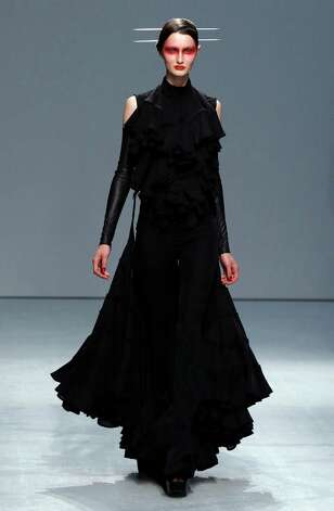 A model presents a creation by Gareth Pugh during the Spring/Summer 2013 ready-to-wear collection show on September 26, 2012 in Paris. AFP PHOTO/FRANCOIS GUILLOT        (Photo credit should read FRANCOIS GUILLOT/AFP/GettyImages) Photo: FRANCOIS GUILLOT, Staff / 2012 AFP