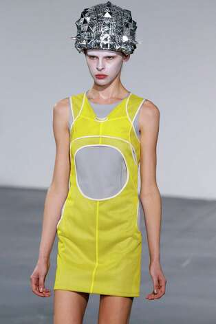 A model presents a creation by Junya Watanabe during the Spring/Summer 2013 ready-to-wear collection show on September 29, 2012 in Paris. AFP PHOTO/PATRICK KOVARIK        (Photo credit should read PATRICK KOVARIK/AFP/GettyImages) Photo: PATRICK KOVARIK, Staff / 2012 AFP