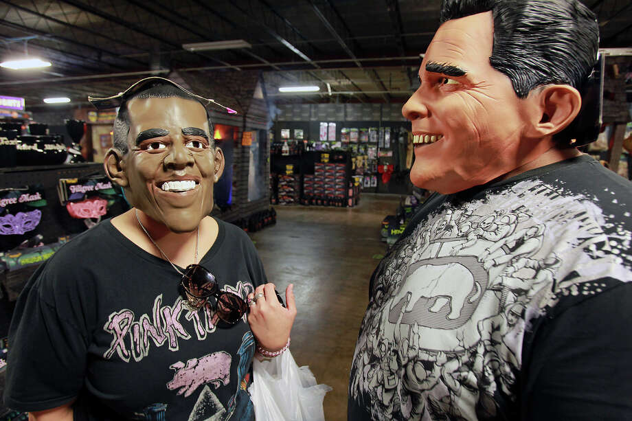 Brandee, left, and John Benavides model masks of President Barack Obama and challenger Mitt Romney at Spirit Halloween at the Wonderland of the Americas mall. Photo: San Antonio Express-News / ©2012 San Antono Express-News