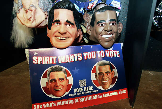 Presidential masks of Mitt Romney and Barack Obama are on sale at Spirit Halloween at the Wonderland of the Americas mall. Photo: Tom Reel, Staff / ©2012 San Antono Express-News