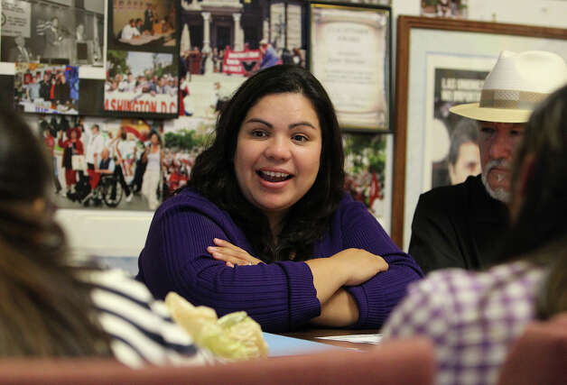 Benita Veliz (center) speaks during a meeting at the Cesar Chavez Legacy and Educational Foundation on Tuesday, Oct. 23, 2012. Veliz was brought into the spotlight of immigration and the Dream Act when she was discovered living most of her life in the U.S. illegally. Since then she has been an advocate for the Dream Act which provides a way for immigrants like herself to gain citizenship instead of deportation. A recent study shows that the passage of the Dream Act could generate $66 billion for the Texas economy. Photo: Kin Man Hui, San Antonio Express-News / San Antonio Express-News
