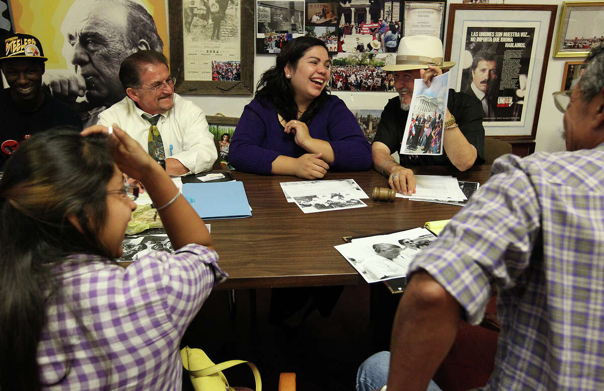 Benita Veliz (center) shares a laugh with Cesar Chavez Legacy and Educational Foundation CEO Jaime Martinez (right) and instructor and coordinator Joseph Fonseca, Jr. (left) during a meeting at the foundation on Tuesday, Oct. 23, 2012. Veliz came into the spotlight of immigration and the Dream Act when she was discovered living most her life in the U.S. illegally. Since then she has been an advocate for the Dream Act which provides a way for immigrants like herself to gain citizenship instead of deportation. A recent study shows that the passage of the Dream Act could generate $66 billion for the Texas economy.