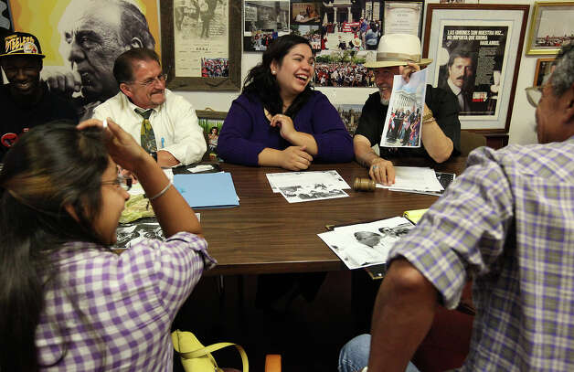 Benita Veliz (center) shares a laugh with Cesar Chavez Legacy and Educational Foundation CEO Jaime Martinez (right) and instructor and coordinator Joseph Fonseca, Jr. (left) during a meeting at the foundation on Tuesday, Oct. 23, 2012. Veliz came into the spotlight of immigration and the Dream Act when she was discovered living most her life in the U.S. illegally. Since then she has been an advocate for the Dream Act which provides a way for immigrants like herself to gain citizenship instead of deportation. A recent study shows that the passage of the Dream Act could generate $66 billion for the Texas economy. Photo: Kin Man Hui, San Antonio Express-News / ©2012 San Antonio Express-News