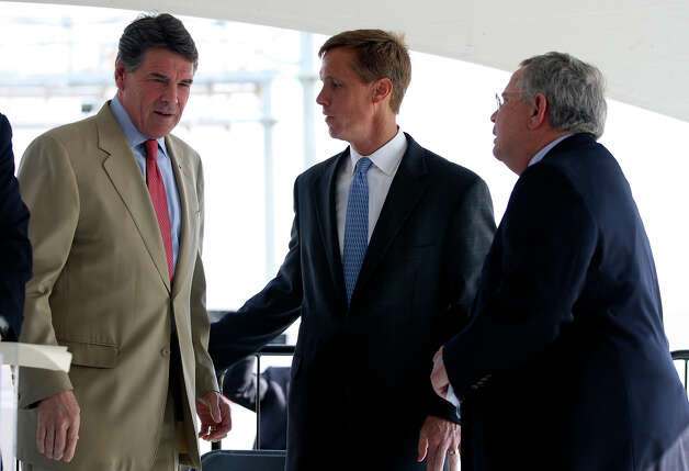 Texas Gov. Rick Perry, left, talks with David S. Zachry, President and CEO of Zachry Corporation, center, and Lockhart Mayor Lew White during a ceremony for the opening of Texas 130 just west of Lockhart, Texas, Wednesday, Oct. 24, 2012. The toll road, which runs from IH-10 just east of Seguin, will connect with Texas 45, a toll road that circumvents Austin. Motorist will be able to drive 85-miles-per hour on Texas 130. Photo: Jerry Lara, San Antonio Express-News / © 2012 San Antonio Express-News