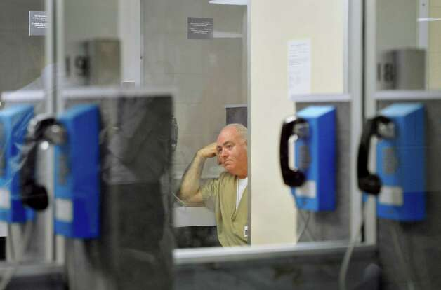 Michael Skakel waits in a visitation room for a decision during a parole hearing at McDougall-Walker Correctional Institution in Suffield, Conn., Wednesday, Oct. 24, 2012. Parole officials denied Skakel's first bid for parole since he was convicted a decade ago of killing his neighbor in 1975. Skakel is serving 20 years to life for fatally beating Martha Moxley with a golf club in Greenwich when they were 15-year-old neighbors. Photo: Jessica Hill, Jessica Hill/Associated Press / Greenwich Time contributed Associated Press