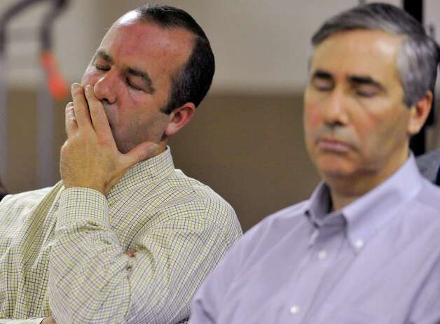 Stephen Skakel, left, and John Skakel, brothers of Michael Skakel, listen during a parole hearing at McDougall-Walker Correctional Institution in Suffield, Conn., Wednesday, Oct. 24, 2012. Parole officials denied Michael Skakel's first bid for parole since he was convicted a decade ago of killing his neighbor in 1975. Skakel is serving 20 years to life for fatally beating Martha Moxley with a golf club in Greenwich when they were 15-year-old neighbors. Photo: Jessica Hill, Associated Press / Greenwich Time contributed Associated Press