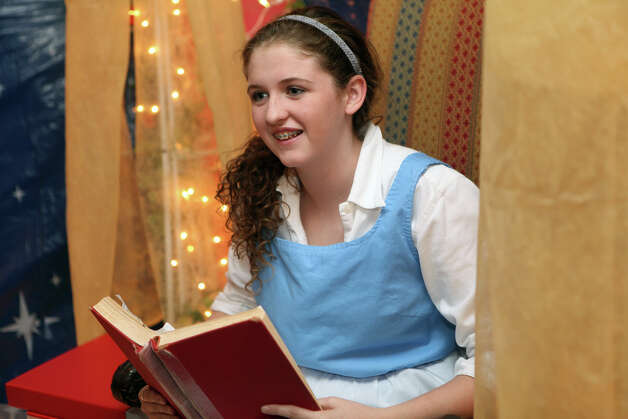 "Belle, Maggie Sullivan, 14, tells her story to children at the Auxiliary of Ahlbin Centers for Rehabilitation's ""Enchanted Castle"" at the Burr Mansion in Fairfield, Conn. on Sunday, October 21, 2012. The storybook experience is open Wednesday, October 24, through Monday, October 29. Photo: B.K. Angeletti / Connecticut Post freelance B.K. Angeletti"