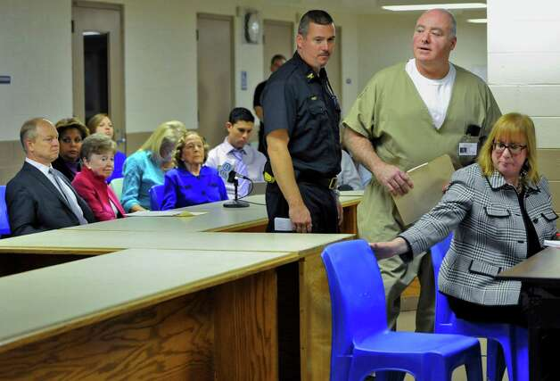 Michael Skakel, second from right, arrives at a parole hearing as family of Martha Moxley, left, look on, at McDougall-Walker Correctional Institution in Suffield, Conn., Wednesday, Oct. 24, 2012.  Parole officials denied Skakel's first bid for parole since he was convicted a decade ago of killing his neighbor in 1975. Skakel is serving 20 years to life for fatally beating Martha Moxley with a golf club in Greenwich when they were 15-year-old neighbors. Photo: Jessica Hill, Jessica Hill/Associated Press / Greenwich Time contributed Associated Press