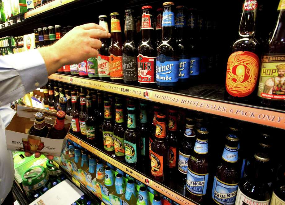 Favor, an on-demand delivery company acquired by H-E-B in February, will now deliver wine and beer throughout the Houston area in less than an hour.  Keep going to see photos of the new H-E-B that opened in Bellaire. Photo: Brett Coomer / © 2012 Houston Chronicle