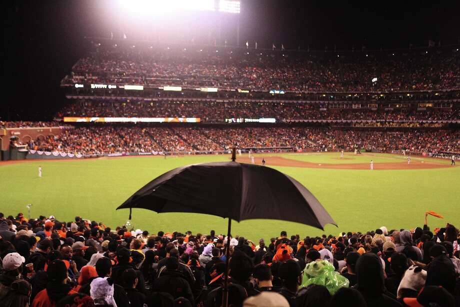 Giants fans respond to scattered rain during Game 7 of the NLCS between the San Francisco Giants and the St. Louis Cardinals at AT&T Park Monday, October 22, 2012 in San Francisco, Calif. Photo: Pete Kiehart, The Chronicle / ONLINE_YES