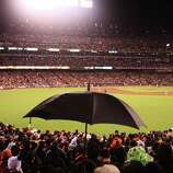 Giants fans respond to scattered rain during Game 7 of the NLCS between the San Francisco Giants and the St. Louis Cardinals at AT&T Park Monday, October 22, 2012 in San Francisco, Calif.