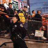 SFPD Officer Michelle Alvis receives a kiss on the hand from Giants fan Eddie Nazlou, of Santa Clara, after she gave him a high five, at right, James Adams, from Landmark Security, looks on during Game 7 of the NLCS between the San Francisco Giants and the St. Louis Cardinals at AT&T Park Monday, October 22, 2012 in San Francisco, Calif.
