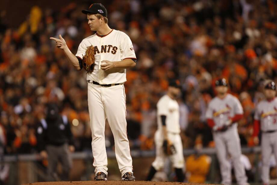 Giants' pitcher Matt Cain points to Marco Scutaro after throwing a pitch that hit Cardinals' left fielder Matt Holliday in the 6th inning during game 7 of the NLCS at AT&T Park on Monday, Oct. 22, 2012 in San Francisco, Calif. Photo: Michael Macor, The Chronicle / ONLINE_YES