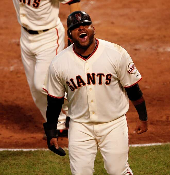 Giants' third baseman Pablo Sandoval screams after scoring in the 3rd inning during game 7 of the NLCS at AT&T Park on Monday, Oct. 22, 2012 in San Francisco, Calif. Photo: Beck Diefenbach, The Chronicle / ONLINE_YES