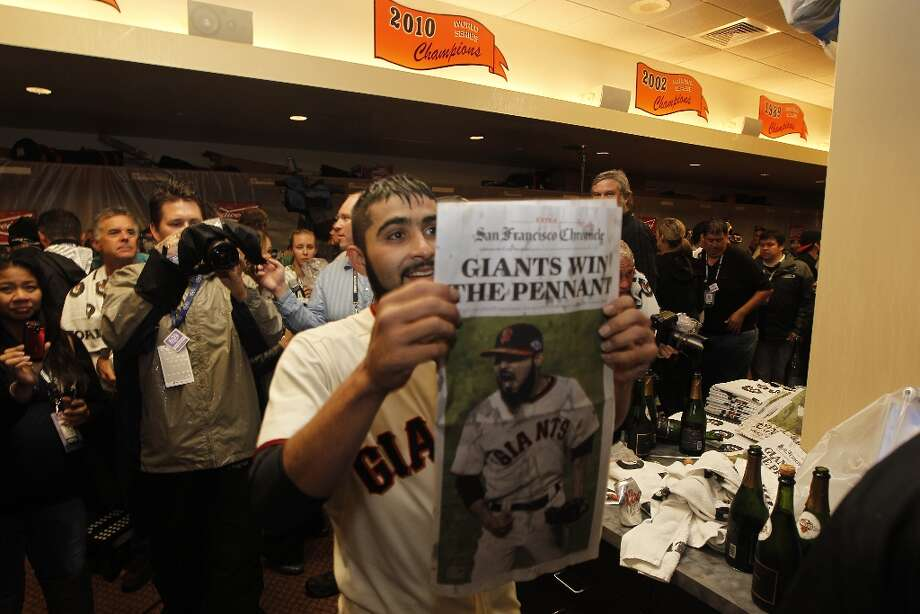 San Francisco  pitcher Sergio Romo displays a newspaper telling of their win  as they celebrate their victory over the St. Louis Cardinals 9-0 to win the NLCS Championship game at AT&T Park Monday, Oct. 22, 2012 in San Francisco, Calif. Photo: Lance Iversen, The Chronicle / ONLINE_YES