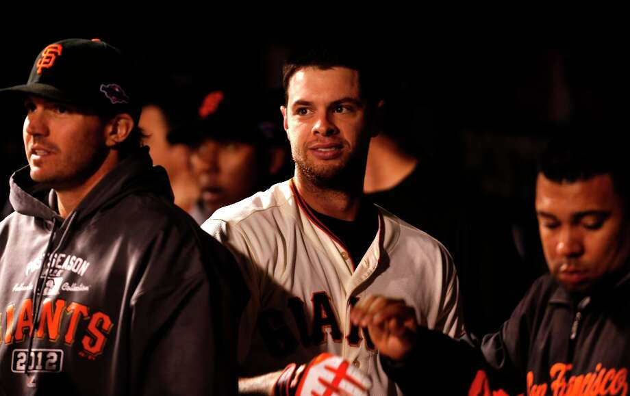 Giants' Brandon Belt returns to the dugout after his solo home run in the eighth inning, as the San Francisco Giants went on to beat the St. Louis Cardinals 9-0 and win the National League Championship Series, on Monday Oct. 22, 2012 at AT&T Park, in  San Francisco, Calif. Photo: Michael Macor, The Chronicle / ONLINE_YES