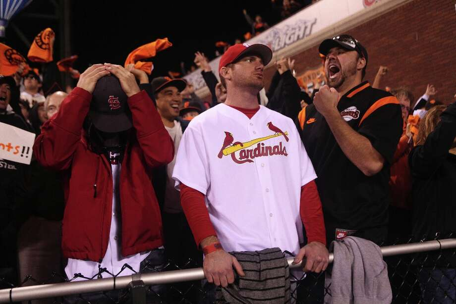 Gavin Owsley, (l-r) Jared Owsley, and Rob Coleman react Game 6 of the NLCS between the San Francisco Giants and the St. Louis Cardinals at AT&T Park Sunday, October 21, 2012 in San Francisco, Calif. The three friends traveled to the game from Nevada. Photo: Pete Kiehart, The Chronicle / ONLINE_YES