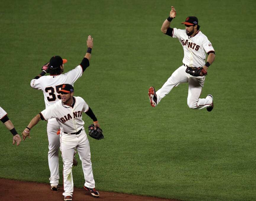 Angel Pagan leaps into the air in celebration of the Giants 6-1 win over the St. Louis Cardinals in game six of the NLCS at AT&T Park on Sunday, Oct. 21, 2012 in San Francisco, Calif. Photo: Lance Iversen, The Chronicle / ONLINE_YES