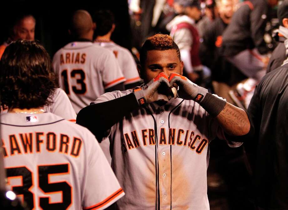 Giants' Pablo Sandoval gestures with his hands after his eighth inning home run, as the San Francisco Giants beat the St. Louis Cardinals 5-0 in game five of the National League Championship Series, on Friday Oct. 19, 2012 at Busch Stadium , in  St. Louis, Mo. Photo: Michael Macor, The Chronicle / ONLINE_YES