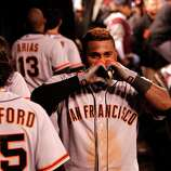 Giants' Pablo Sandoval gestures with his hands after his eighth inning home run, as the San Francisco Giants beat the St. Louis Cardinals 5-0 in game five of the National League Championship Series, on Friday Oct. 19, 2012 at Busch Stadium , in  St. Louis, Mo.