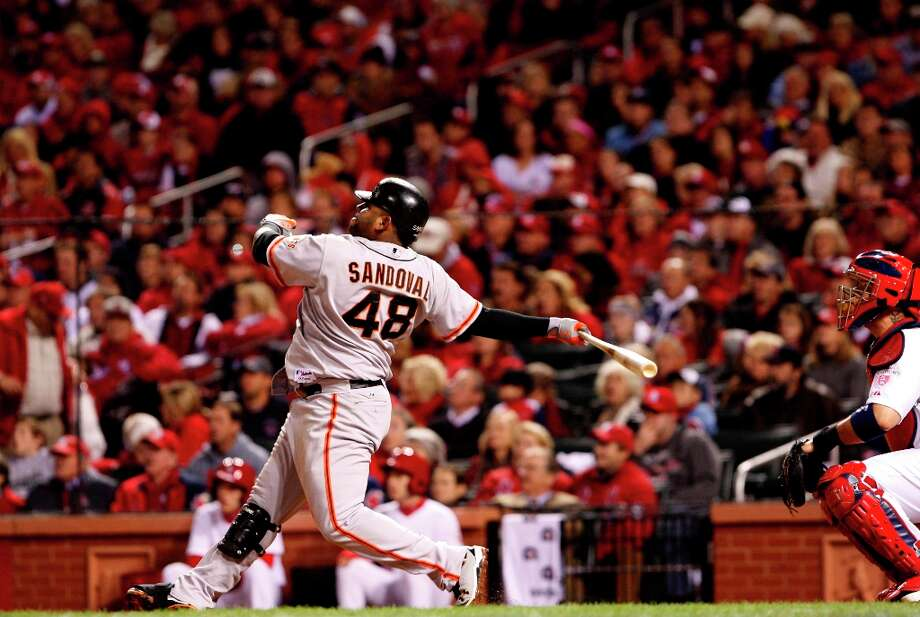 Giants' Pablo Sandoval watches his eighth inning home run, as the San Francisco Giants beat the St. Louis Cardinals 5-0 in game five of the National League Championship Series, on Friday Oct. 19, 2012 at Busch Stadium , in  St. Louis, Mo. Photo: Michael Macor, The Chronicle / ONLINE_YES