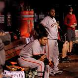 Giants' Hector Sanchez, (left) and Pablo Sandoval watch their teammates at bat in the ninth inning, as the San Francisco Giants went on to lose to the St. Louis Cardinals 8-3 in game four of the National League Championship Series, on Thursday Oct. 18, 2012 at Busch Stadium , in  St. Louis, Mo. St. Louis now leads the series three games to one.