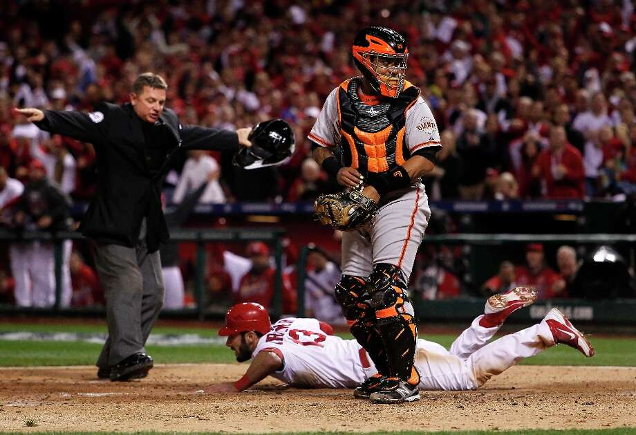 The Cardinals Matt Carpenter is safe at home as the ball got loose from Giants catcher Hector Sanchez in the fifth inning, as the San Francisco Giants take on the St. Louis Cardinals in game four of the National League Championship Series, on Thursday Oct. 18, 2012 at Busch Stadium , in  St. Louis, Mo. Photo: Michael Macor, The Chronicle / ONLINE_YES