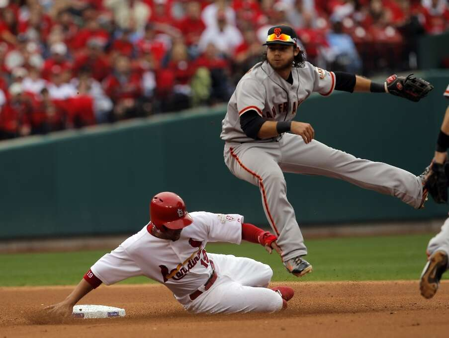 Brandon Crawford completes the throw to first as Jon Jay slides past on a double play that Carlos Beltran hit into in the first inning. The San Francisco Giants played the St. Louis Cardinals in Game 3 of the National League Championship Series at Busch Stadium on Wednesday, October 17, 2012, in St. Louis, Mo. Photo: Carlos Avila Gonzalez, The Chronicle / ONLINE_YES