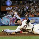San Francisco Giants' Gregor Blanco dives safely back to first base past St. Louis Cardinals' Allen Craig on a fly ball by Brandon Crawford during the eighth inning in Game 2 of baseball's National League championship series against the San Francisco Giants on Monday, Oct. 15, 2012, in San Francisco.