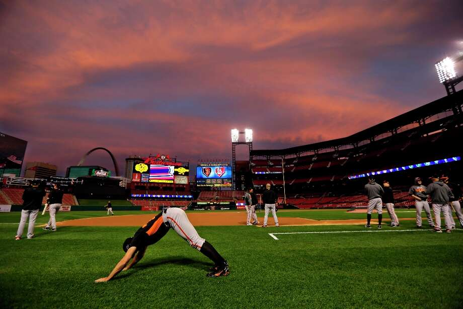 San Francisco Giants pitcher Barry Zito, foreground, stretches at the start of baseball practice Tuesday, Oct. 16, 2012, in St. Louis. The Giants are scheduled to play the St. Louis Cardinals in Game 3 of baseball's National League championship series Wednesday in St. Louis. Photo: Jeff Roberson, Associated Press / AP