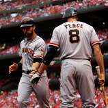San Francisco Giants' Angel Pagan celebrates a run with Hunter Pence during the third inning of Game 3 of baseball's National League championship series against the St. Louis Cardinals, Wednesday, Oct. 17, 2012, in St. Louis.