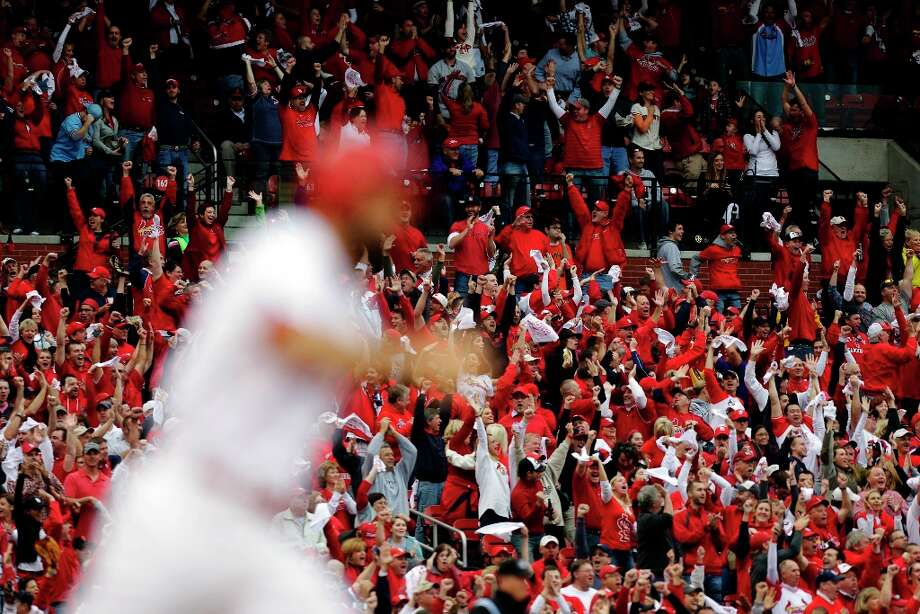 Fans celebrate after St. Louis Cardinals' Matt Carpenter, foreground, hit a two-run home run against the San Francisco Giants during the third inning of Game 3 of baseball's National League championship series, Wednesday, Oct. 17, 2012, in St. Louis. Photo: Chris Lee, Associated Press / St. Louis Post-Dispatch