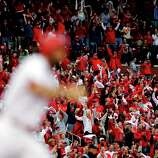 Fans celebrate after St. Louis Cardinals' Matt Carpenter, foreground, hit a two-run home run against the San Francisco Giants during the third inning of Game 3 of baseball's National League championship series, Wednesday, Oct. 17, 2012, in St. Louis.