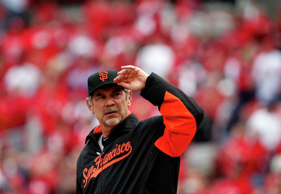 Giants' manager Bruce Bochy looks to the stands during the introductions, as the San Francisco Giants prepare to take on  the St. Louis Cardinals  in game three, of the National League Championship Series  which is tied at 1-1, on Wednesday Oct. 17, 2012. at Busch Stadium ,  in  St. Louis, Mo. Photo: Michael Macor, The Chronicle / ONLINE_YES