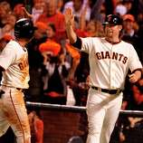 Gregor Blanco (left) and Aubrey Huff celebrated their scoring in the 8th inning. The San Francisco Giants defeated the St. Louis Cardinals 7-1 Monday October 15, 2012 at AT&T park in the second game of the League Championship.