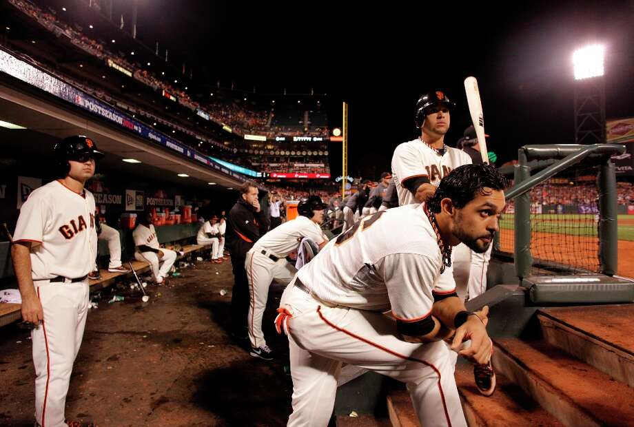 GIants' Gregor Blanco, (top)  and Angel Pagan, (front) keep a close watch on their teamates batting in the eighth inning, as the San Francisco Giants went on to lose the St. louis Cardinals 6-4 in game one of the National League Championship Series at AT&T Park,  the San Francisco, Ca.,  on Sunday Oct. 14, 2012. Photo: Michael Macor, The Chronicle / ONLINE_YES