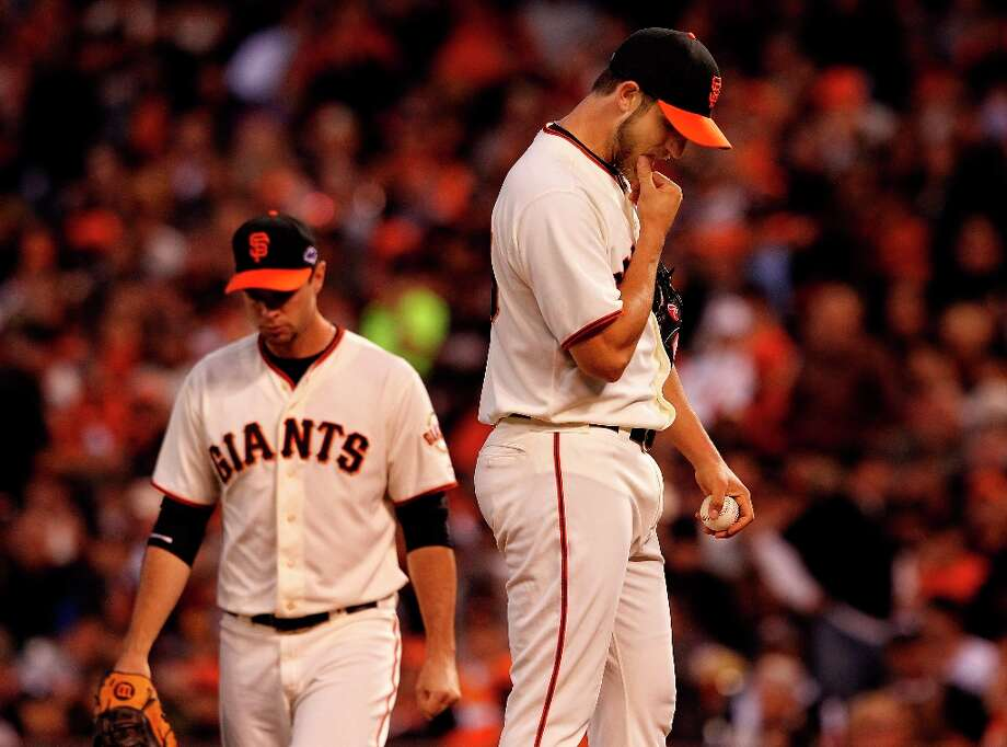 Madison Bumgarner (right) stood on the mound after giving up a home run to David Freese. The San Francisco Giants lost 6-4 to the St. Louis Cardinals in the first game of the league championship series Sunday Octboer 14, 2012 at AT&T park. Photo: Brant Ward, The Chronicle / ONLINE_YES