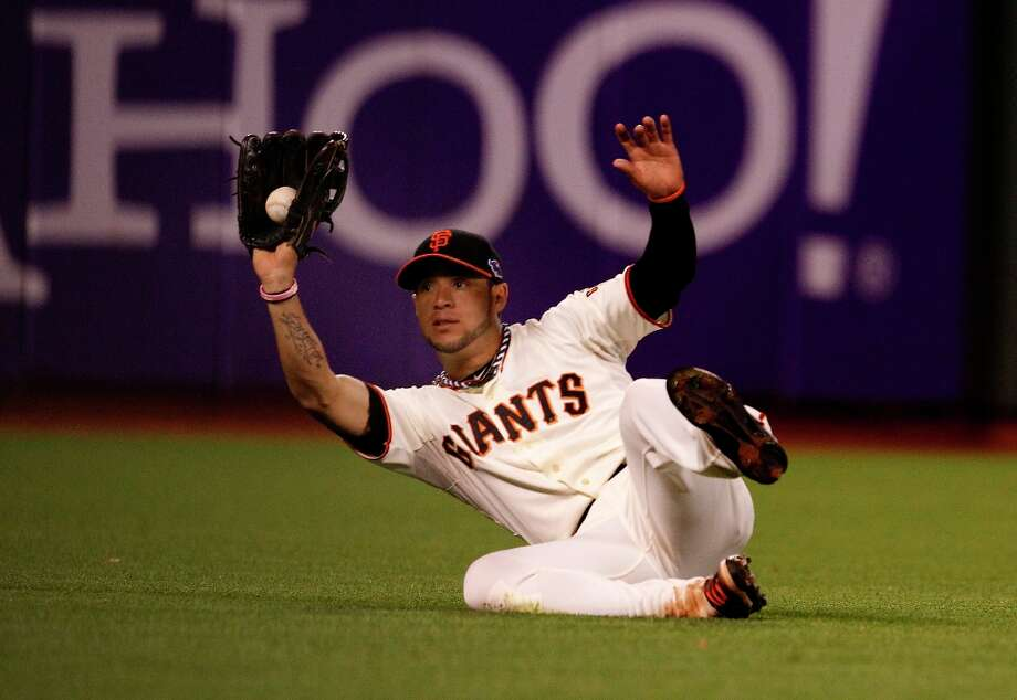 Gregor Blanco made a nice catch on a hit by Skip Schumaker to end the 6th inning. The San Francisco Giants lost 6-4 to the St. Louis Cardinals in the first game of the league championship series Sunday Octboer 14, 2012 at AT&T park. Photo: Brant Ward, The Chronicle / ONLINE_YES