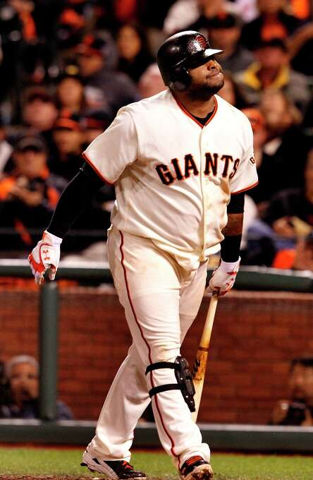 Pablo Sandoval grimaced as he walked back to the dugout after striking out in the 7th inning. The San Francisco Giants lost 6-4 to the St. Louis Cardinals in the first game of the league championship series Sunday Octboer 14, 2012 at AT&T park. Photo: Brant Ward, The Chronicle / ONLINE_YES