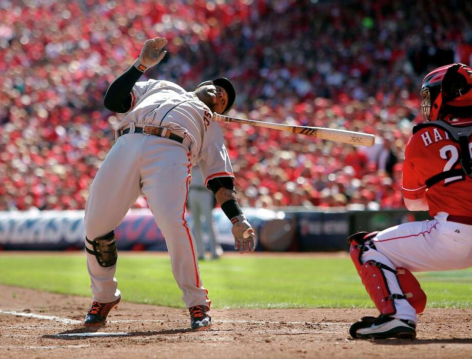Giants Pablo Sandoval backs off an inside pitch in the fourth inning, as the San Francisco Giants take on the Cincinnati Reds in game five of the National League Division Series in Cincinnati, Ohio on Thursday Oct. 11, 2012. Photo: Michael Macor, The Chronicle / ONLINE_YES
