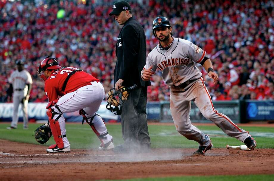Giants' Angel Pagan scores on a sacrifice fly to deep center hit by Pablo Sandoval in the fifth inning, as the San Francisco Giants go on beat the Cincinnati Reds 8-3 to take game four of the National League Division Series in Cincinnati, Ohio on Wednesday Oct. 10, 2012. Photo: Michael Macor, The Chronicle / ONLINE_YES