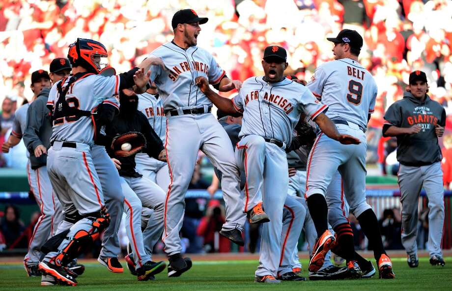 The San Francisco Giants celebrate after they defeated the Cincinnati Reds 6-4 in Game 5 of the National League division baseball series, Thursday, Oct. 11, 2012, in Cincinnati.  The Giants won the final three games, all in Cincinnati, and advanced to the NL championship series. Photo: Michael Keating, Associated Press / FR170759 AP