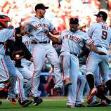 The San Francisco Giants celebrate after they defeated the Cincinnati Reds 6-4 in Game 5 of the National League division baseball series, Thursday, Oct. 11, 2012, in Cincinnati.  The Giants won the final three games, all in Cincinnati, and advanced to the NL championship series.