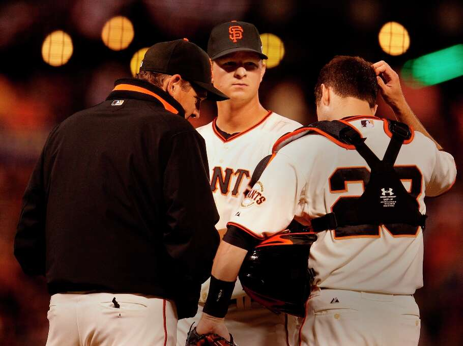 Matt Cain got a visit from pitching coach Dave Righetti in the third inning. The San Francisco Giants and the Cincinnati Reds in game one of the National League Division Series Saturday October 6, 2012 at AT&T park. Photo: Brant Ward, The Chronicle / ONLINE_YES