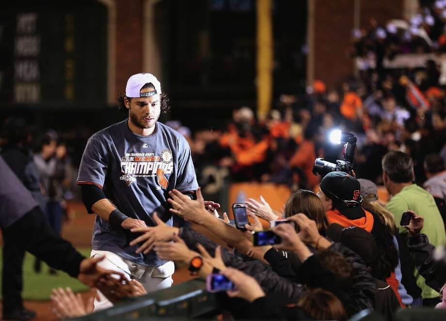Brandon Crawford #35 of the San Francisco Giants does a victory lap after the San Francisco Giants beat the San Diego Padres to clinch the National League West Division Title at AT&T Park on September 22, 2012 in San Francisco, California. Photo: Ezra Shaw, Getty Images / 2012 Getty Images