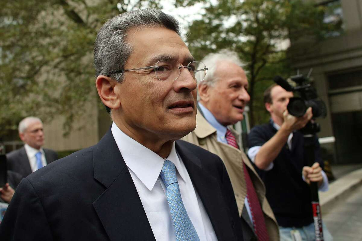 Rajat Gupta (L), former Goldman Sachs Inc. director and former senior partner at McKinsey & Co., enters Federal court with his lawyer Gary Naftalis for his sentencing on October 24, 2012 in New York City. Gupta, 63, was convicted by a federal jury in June for leaking inside information to hedge-fund manager Raj Rajaratnam.