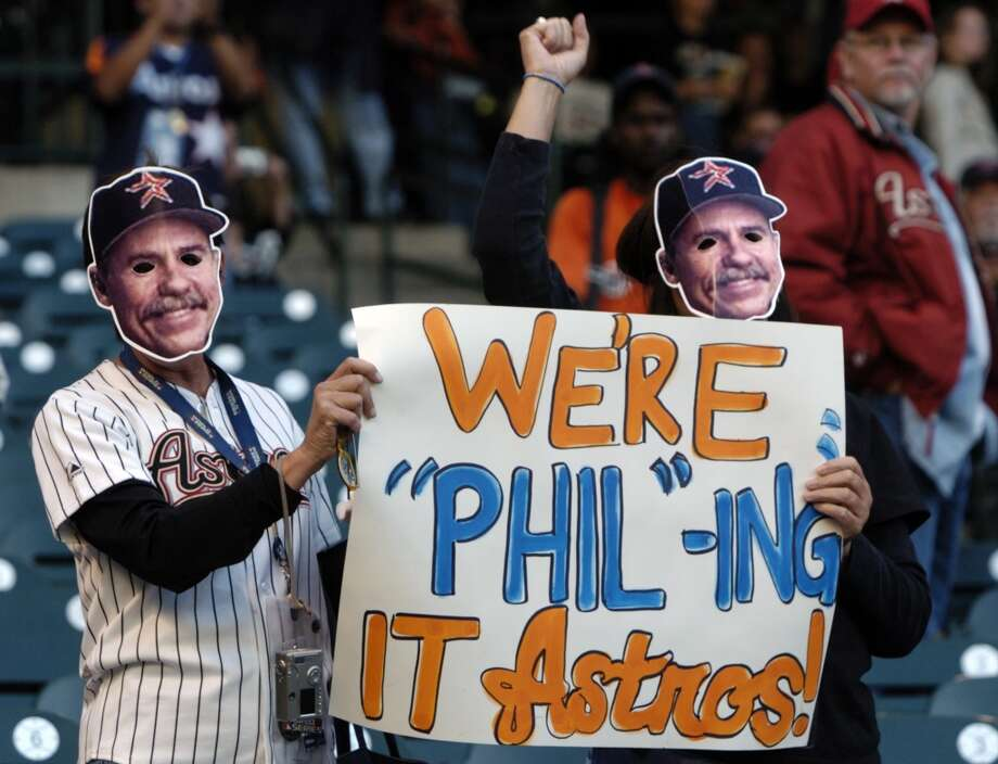 Jackie Show (left, Pearland) and her sister Janet Gantenbein (Deer Park) show their support for manager Phil Garner prior to the start of Game 4. (Melissa Phillip / Chronicle)