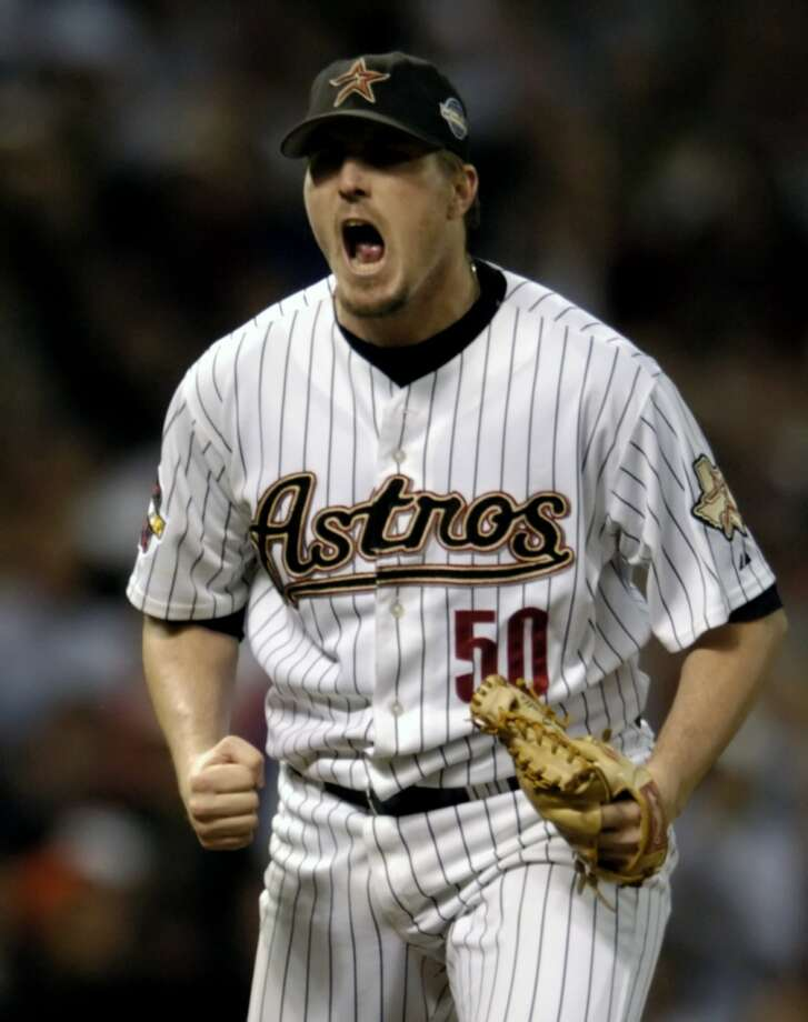 Astros pitcher Chad Qualls celebrates after getting the third out in the 12th inning during Game 3. (Melissa Phillip / Chronicle)