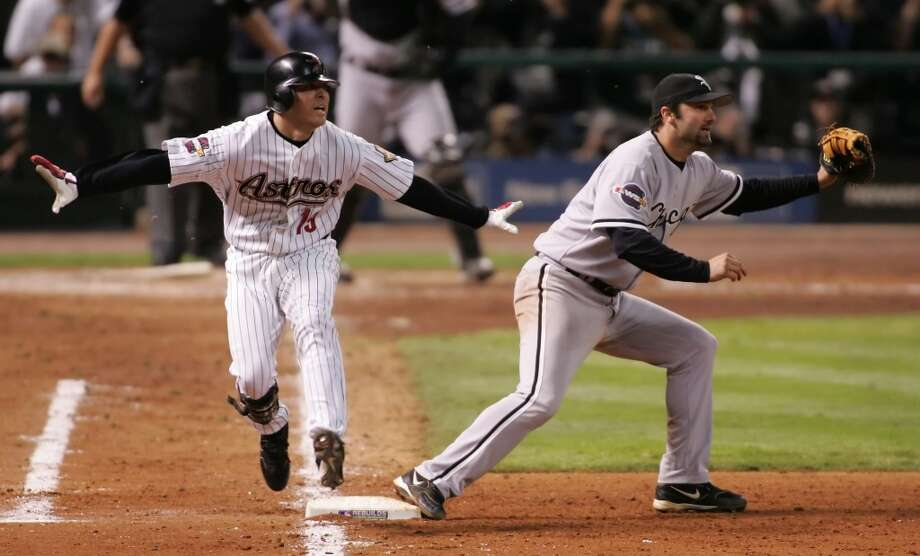 Orlando Palmeiro tries to call himself safe at first, but was out on the throw to Chicago's Paul Konerko to end the four game sweep of the Astros for the White Sox first World Series championship since 1917. (Steve Ueckert / Chronicle)